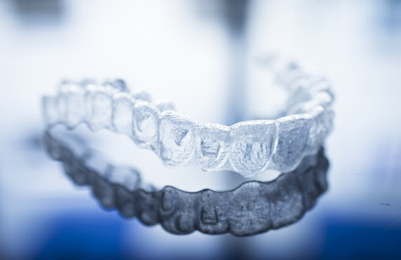 Should I Get Invisalign From A Dentist Or Orthodontist?